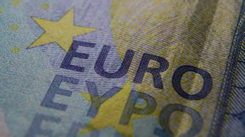 Macro shot Twenty euros. Super macro of embossing EURO on a blue banknote.
