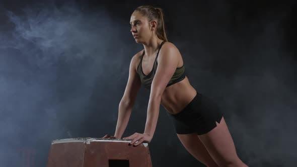 Thumbnail for Woman Performing Incline Push Ups