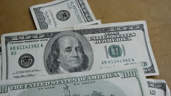 Rotating stock footage shot of $100 bills - MONEY 0148