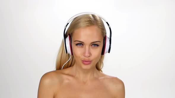 Thumbnail for Beautiful Female in Headphones Listening To the Music with Fluttering on the Wind Hair Over White