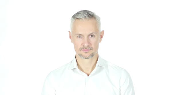 Thumbnail for Middle Aged Businessman Looking Into Camera, Grey Haired