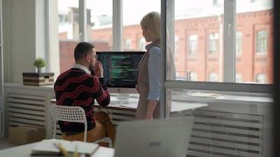 Colleagues Discussing Program Code