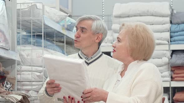 Thumbnail for Happy Elderly Couple Laughing, Talking While Shopping for Home Goods
