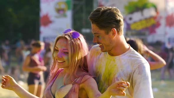 Cover Image for Couple Tenderly Hugging and Dancing at Holi Color Festival, Slow Motion