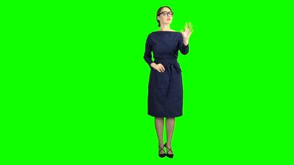 Businesswomen on a Virtual Board Makes Calculations of Their Income. Green Screen