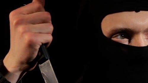 Kriminelle mit einem Messer
