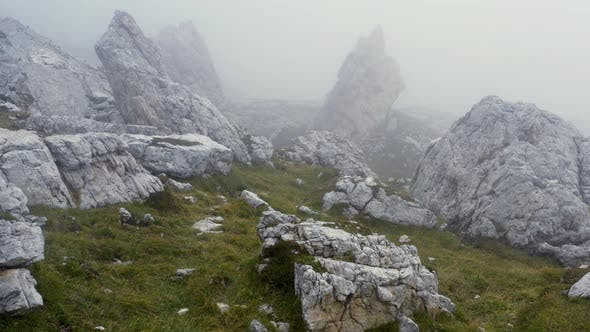 Thumbnail for Fly in the fog over rocks