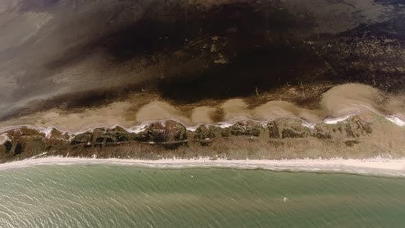 Thumbnail for Aerial Shot of a Hilly Sandy Coastline at the Black Sea on a Sunny Day in Summer