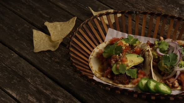 Rotating Shot of Delicious Tacos on A Wooden Surface