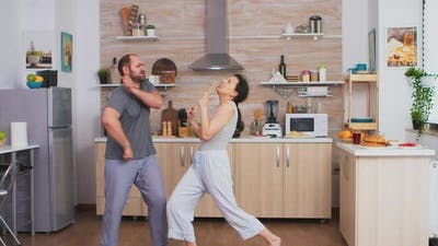 Funny Couple Dancing in Kitchen