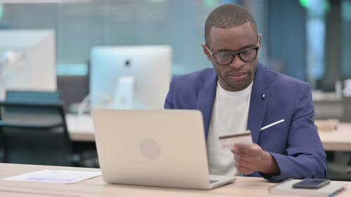 Online Payment Failure on Laptop By African Businessman