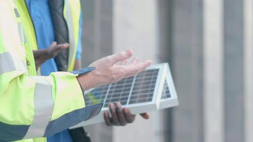 Close up hands diversity engineer discuss with tablet and solar cell