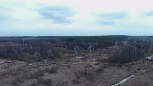 Power lines from bird eyes view. High-voltage tower and wires. Energy efficiency conception.