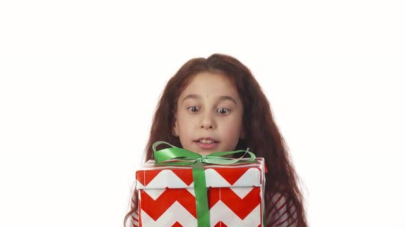 Thumbnail for The Surprised Girl Is Delighted with Her Gift