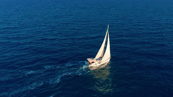 Thumbnail for Aerial View. Yacht Sailing on Open Sea at Sunny Day