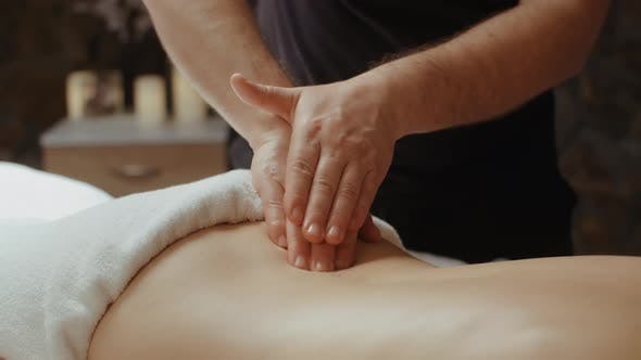Thumbnail for Male Masseur Doing Back Massage. Slim Woman Receiving Lumbar Massage in Spa, Relaxing