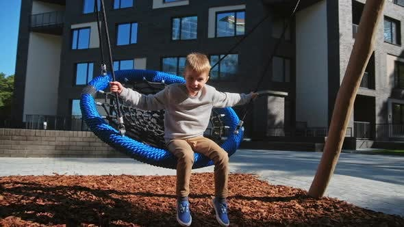Thumbnail for Child Boy Enjoy at Swing at Playground Near Home