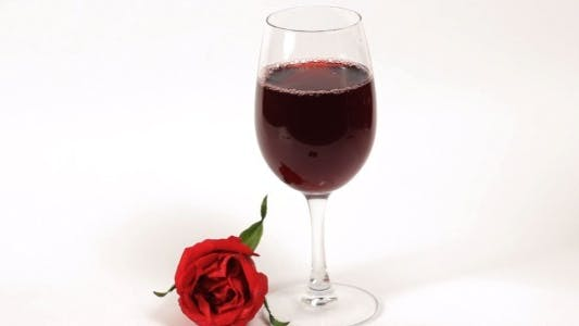Thumbnail for Pouring Red Wine with a Rose