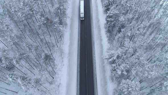 Thumbnail for Cars Driving on Winter Road Aerial View