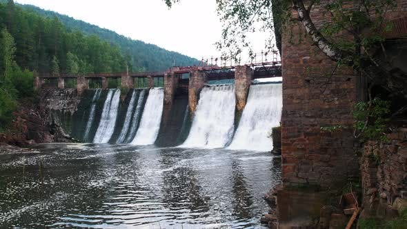 Thumbnail for Water Dam in the Forest - River Water Falls Down Under the Bridge