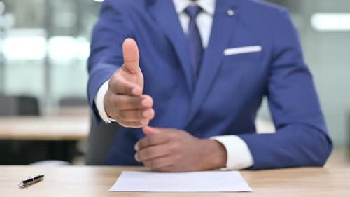Hand of African Businessman Showing Hand Shake Gesture