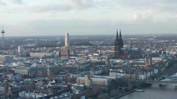 Thumbnail for AERIAL: Wide Shot of Cologne Germany and Rhine River From the Air with Majestic Cathedral on Sunny
