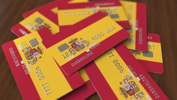 Cover Image for Pile of Credit Cards with Flag of Spain