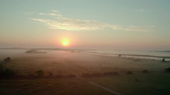 Aerial Drone View. Beautiful Misty Dawn in the Spring on the Lake. and Rural Road V2