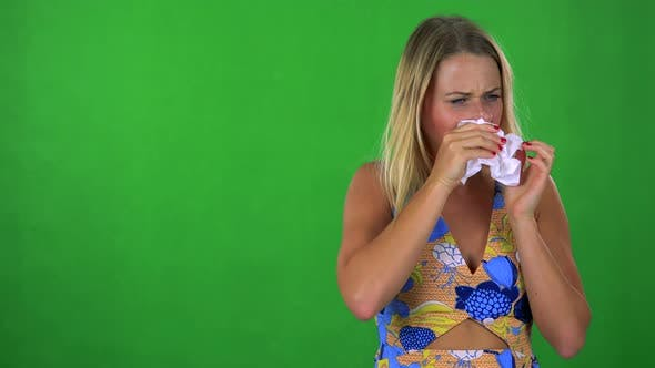 Thumbnail for Young Pretty Blond Woman Blow One's Nose - Green Screen - Studio