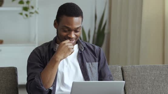 Thumbnail for Foreign Student Millennial of African Ethnicity American Man Emotional Guy Sitting at Home on Couch