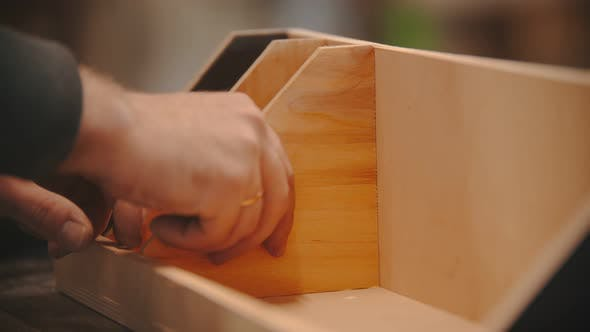 Thumbnail for Carpentry Working - Hands of Man Worker Glueing the Wooden Parts - Making a Wooden Organizer