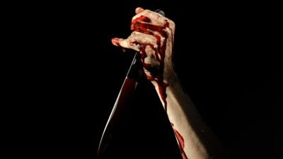 Bloody Hand with a Knife