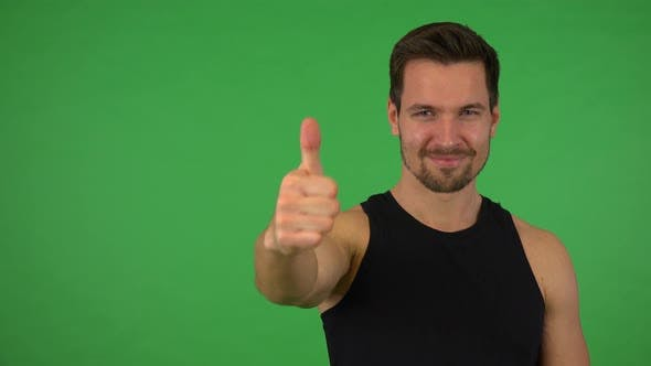 Thumbnail for A Young Handsome Athlete Shows a Thumb Up To the Camera and Nods with a Smile - Green Screen Studio