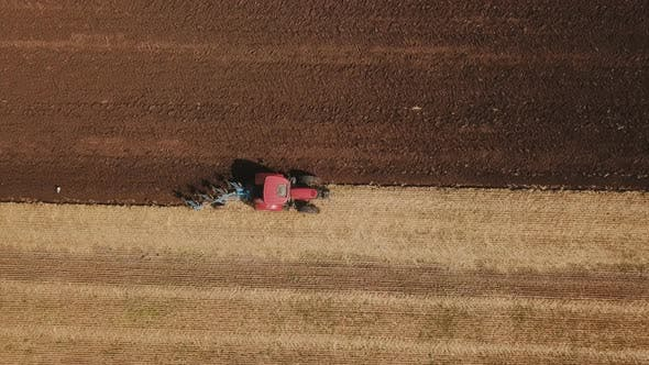 Thumbnail for Red Tractor Plows the Ground