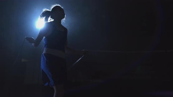 Thumbnail for Young Beautiful Woman Boxer in Training in the Hall Jumping Rope Medium Size Slow Motion