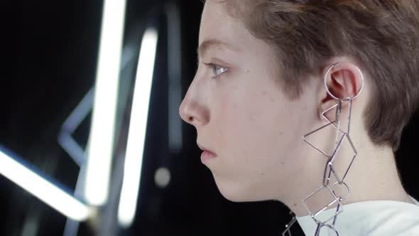 Thumbnail for Young Trendy Woman Wearing Earrings