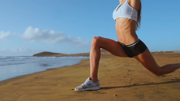 Thumbnail for Fitness Girl Stretching Legs on Beach Training