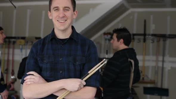 Portrait of garage band musician
