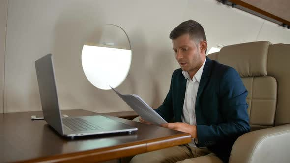 Young Entrepreneur Sleeping Inside of Private Jet Cabin