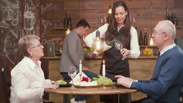 Thumbnail for Waitress Pouring Wine To a Old Couple on a Date