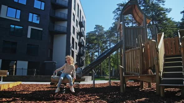 Thumbnail for Beautiful Small Girl Play in Playground at Spring