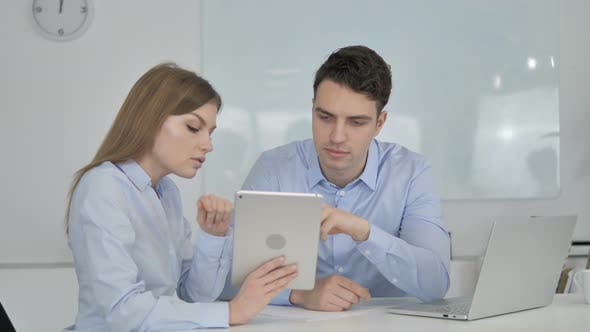 Thumbnail for Business Colleagues Using Tablet in Office, Business Plan