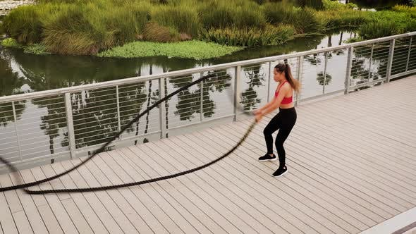 Thumbnail for Aerial shot of a woman working out in the park