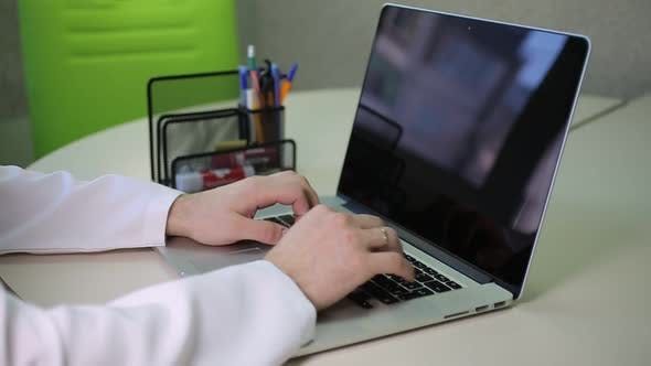 Thumbnail for Doctor Working At His Laptop