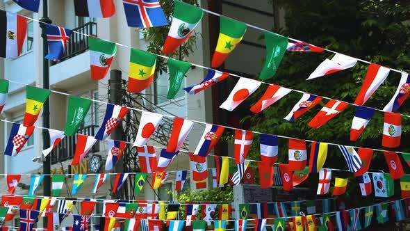 Thumbnail for Flags of Different Countries Hang on City Streets