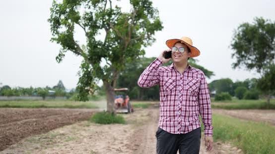 Farmer walking talking on smartphone