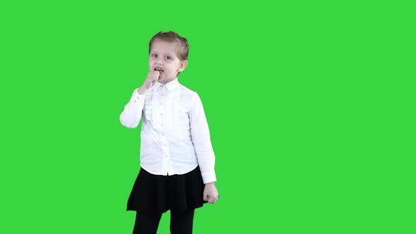 Thumbnail for Cute Happy Girl Singing Into Imaginary Microphone on a Green Screen, Chroma Key.