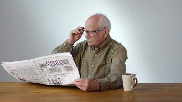 Thumbnail for Charismatic Elderly Man Reading Newspaper