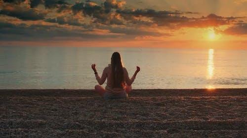Woman Meditating on the Seashore