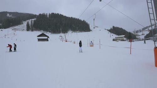 Skiers taking the rope tow